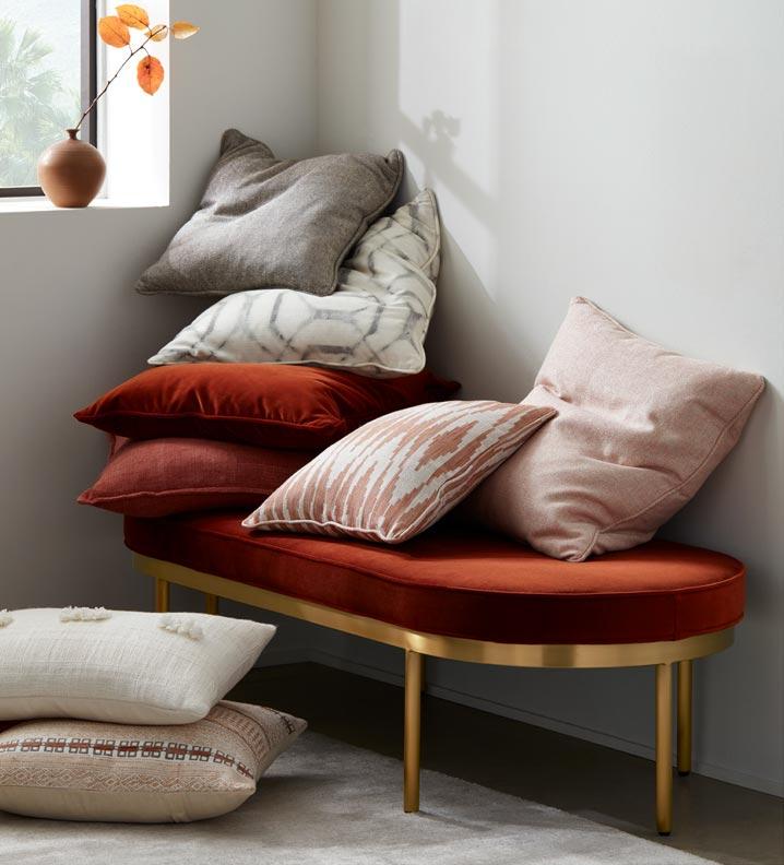 Colburn ottoman with throw pillows