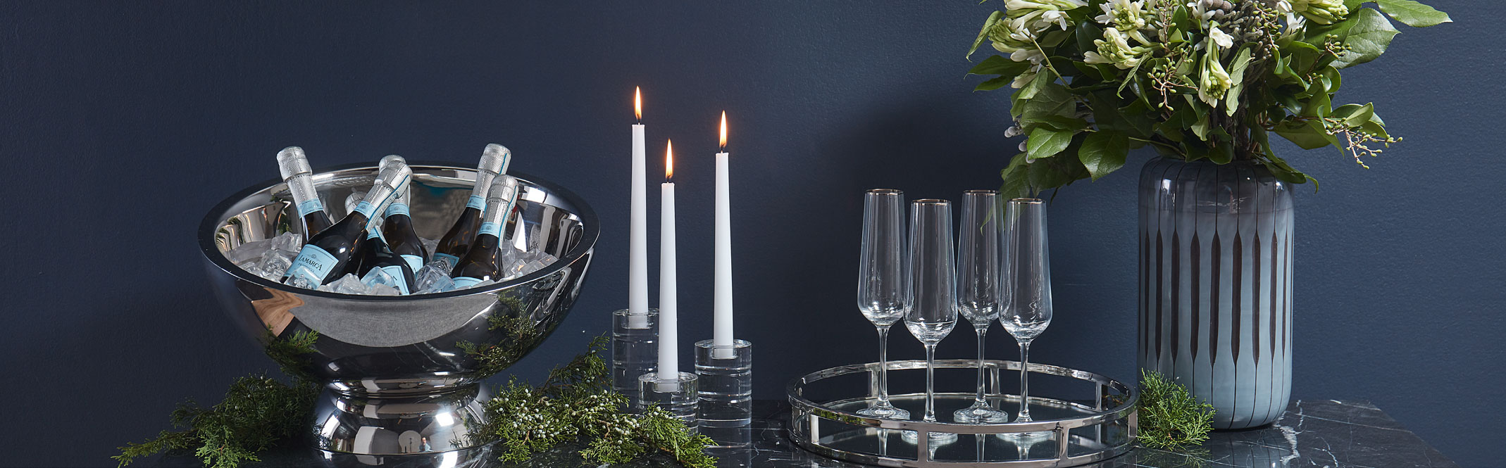 Holiday setting image featuring various barware and other giftable items