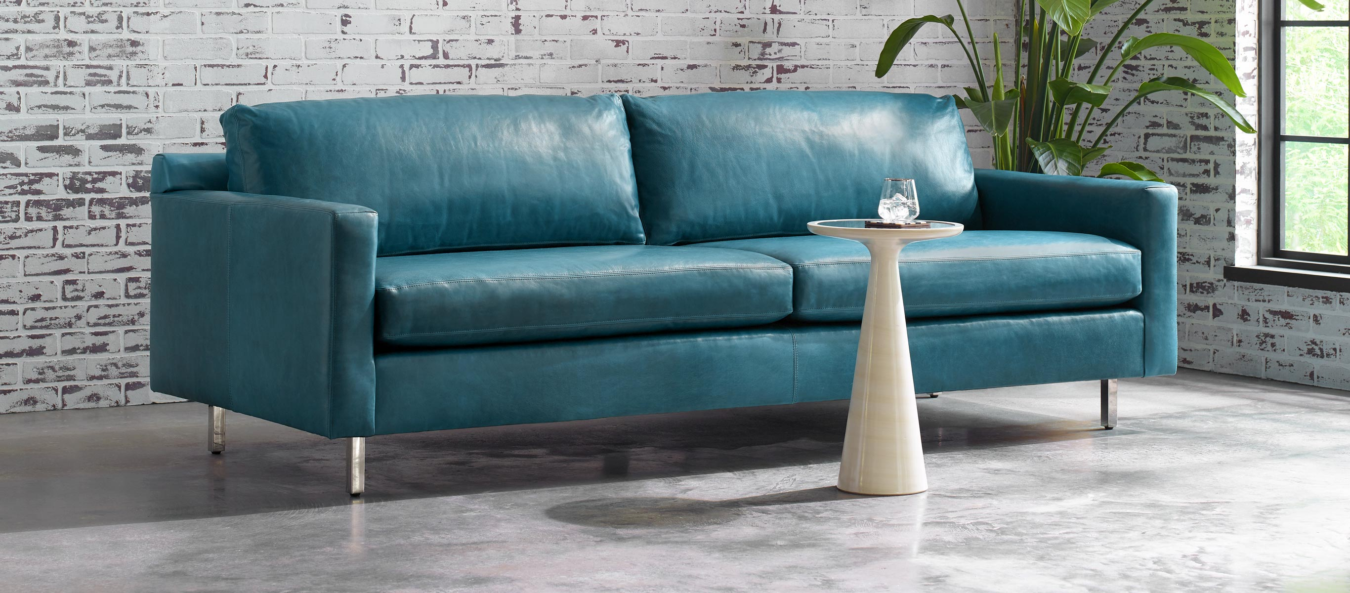 Hunter Leather Sofa in Mont Blanc - Mountain Spring, a blue leather.