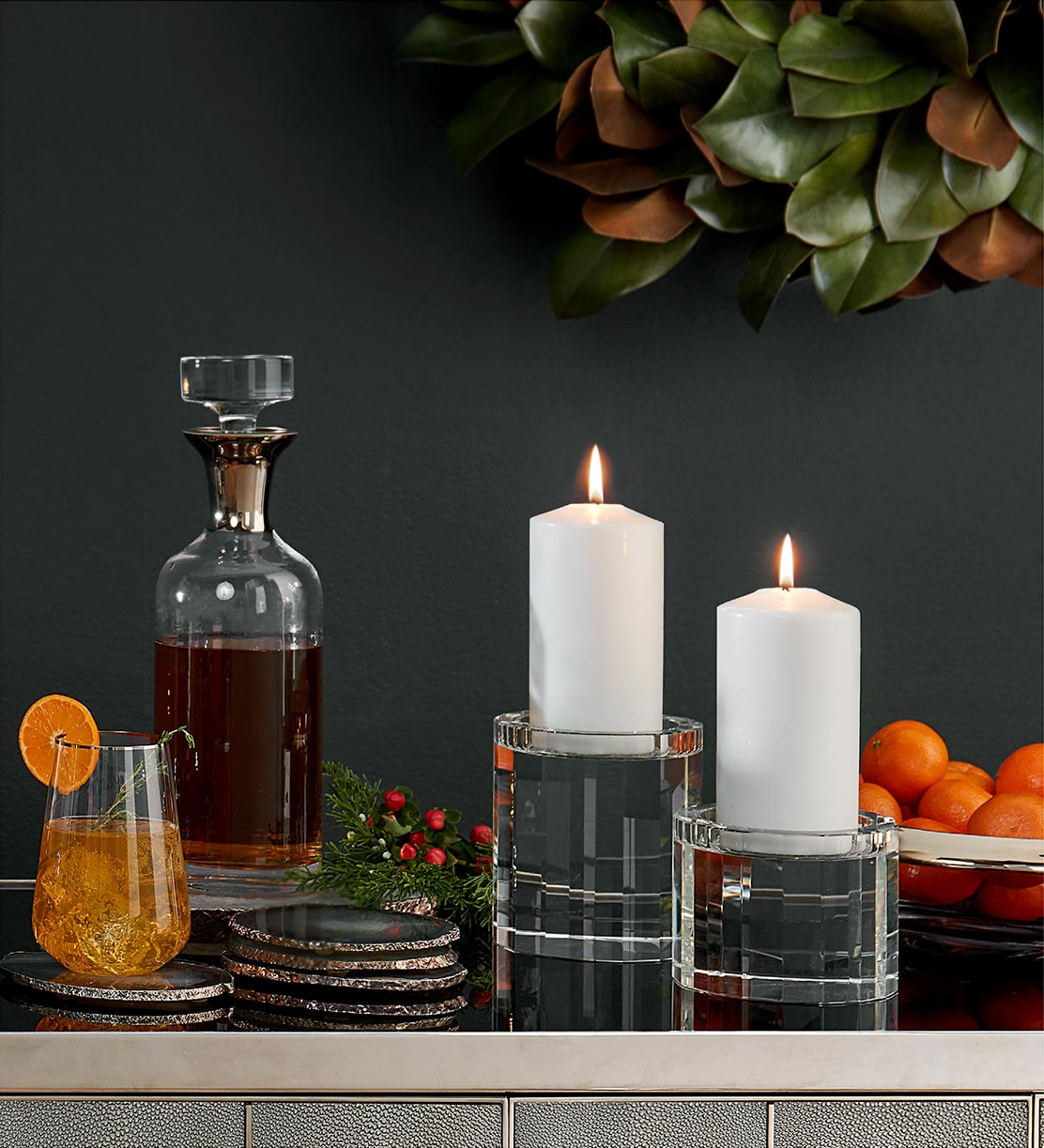 Mix of accessories, including a decanter and candles