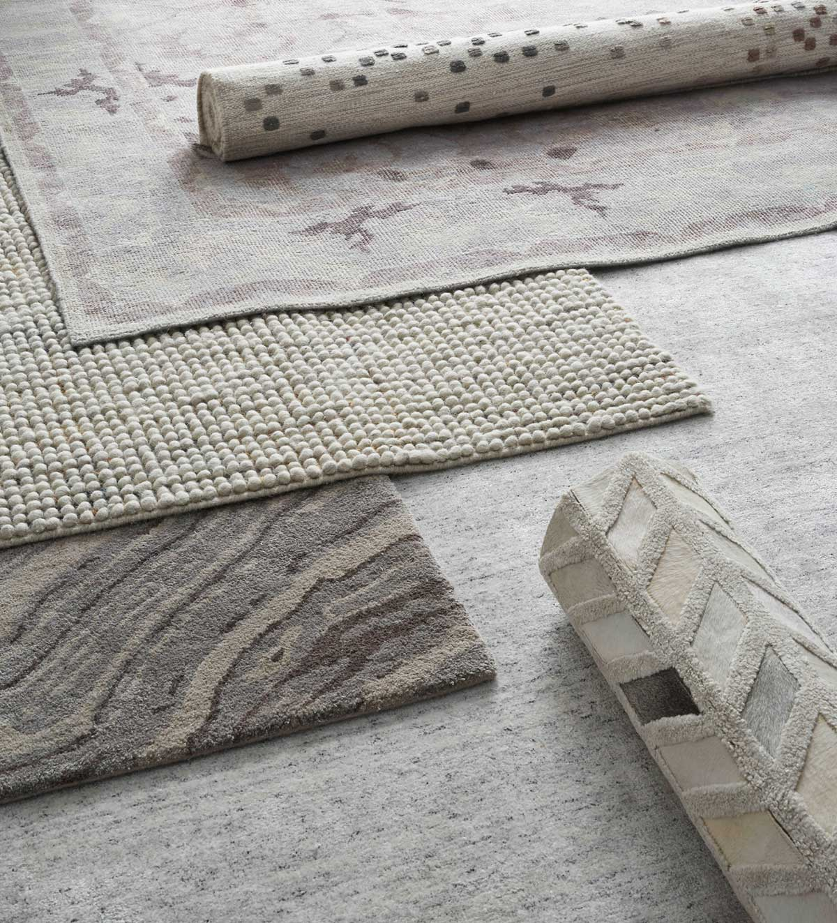 Hand-woven rugs in soothing hues and welcoming textures.